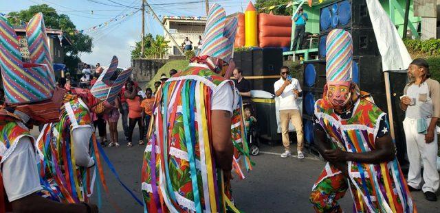 Masqueraders dancing in the streets of Cudjoe Head.