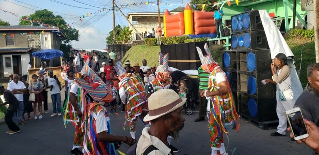 Masqueraders dancing in the streets of Cudjoe Head.