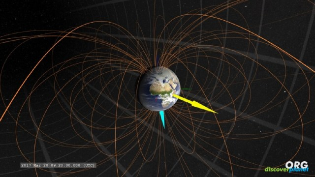 Magnetic monopoles trapped in Earth's strong magnetic field
