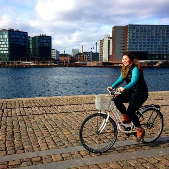 DIS student biking in modern Copenhagen