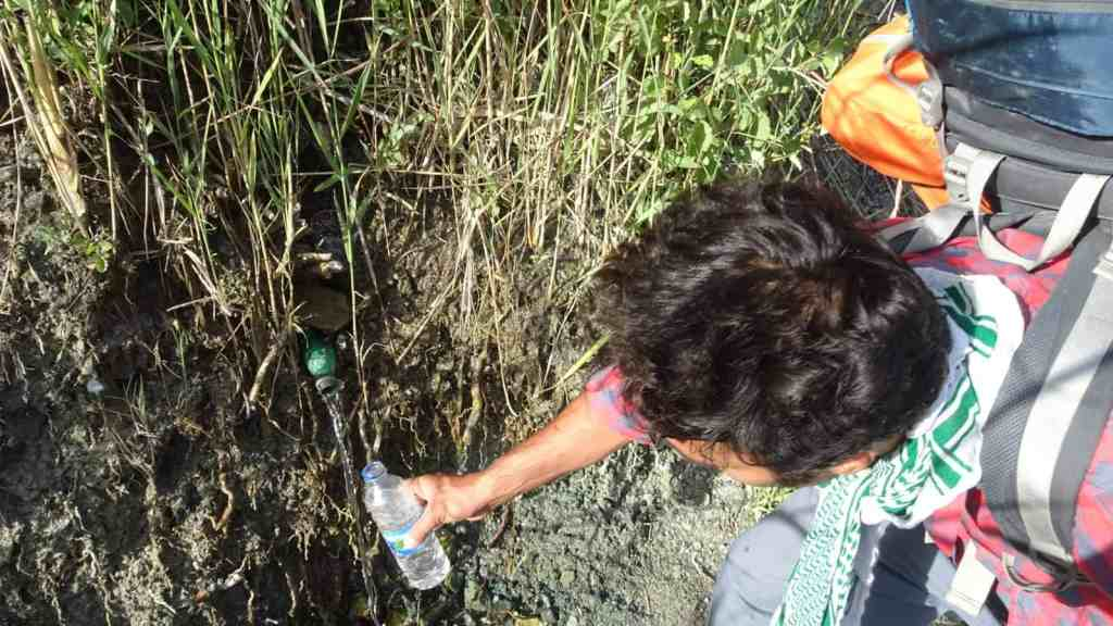 Drinking water from a natural spring. Do notice the plastic cup above the spring