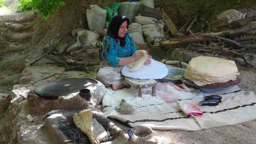 Lady of the house baking traditional Kurdish bread