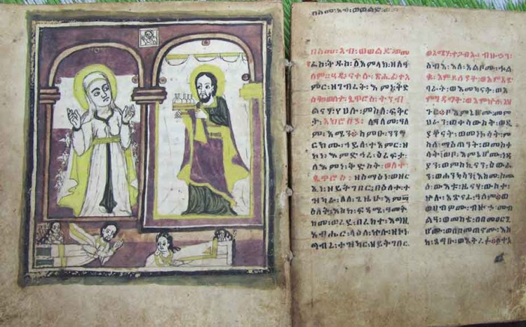 Pages from a 19th-century copy of the book Gadla Walatta Petros (The Life and Struggles of Walatta Petros). On the left page, the saint receives her commission from Christ to start seven religious communities. (Images courtesy of Wendy Laura Belcher)