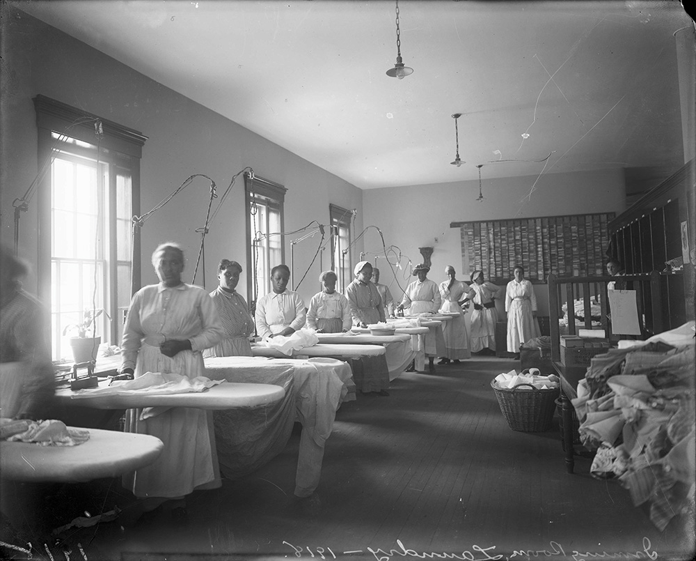Black female patients at work in the laundry at St. Elizabeths Hospital