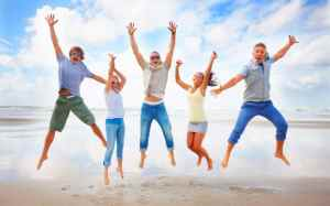 5 happy people jumping in the air