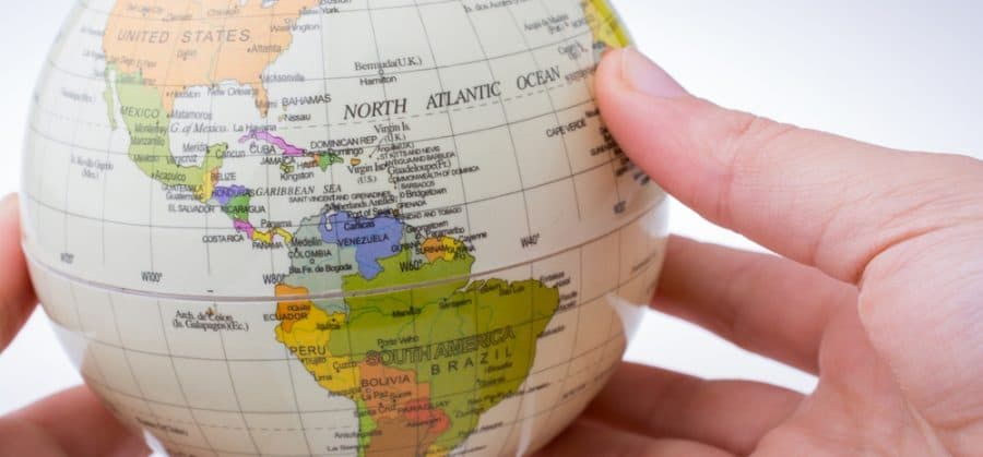 contact us-hands holding a globe