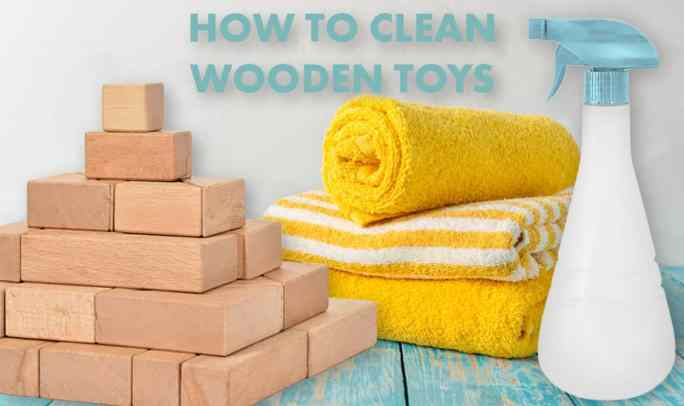 how to clean wooden toys and wooden building blocks-stack of towels, blocks, and a spray bottle