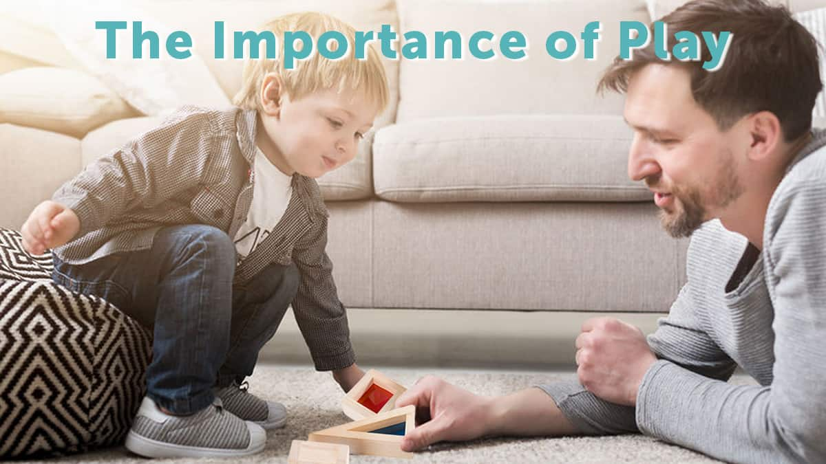 the importance of play-father and son on the floor playing with wooden building blocks