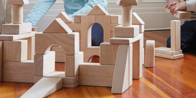 block play-kids building elaborate structures with wooden building blocks