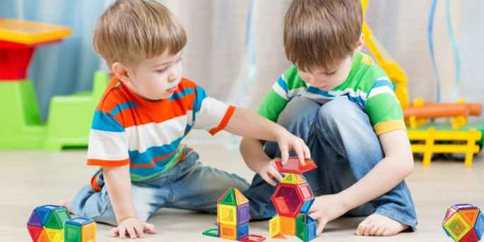 what are social skills-two young boys playing with magnetic tiles