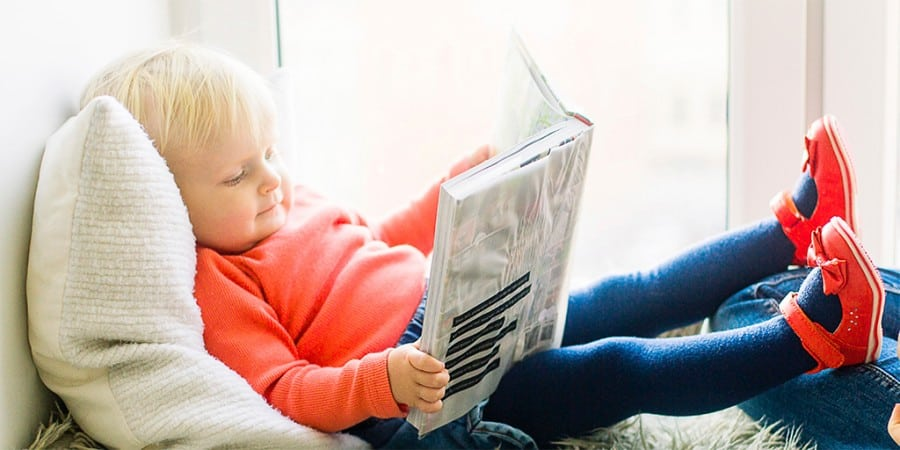 expressive language activities- young girl is reading a book