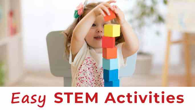 stem activities-engineering for toddlers-toddler girl building a tower with square wooden blocks
