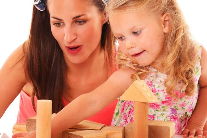 cognitive development in preschoolers-mother and daughter engaged in block play