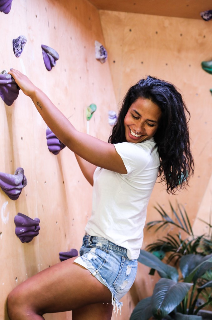 woman bouldering on a climbing wall