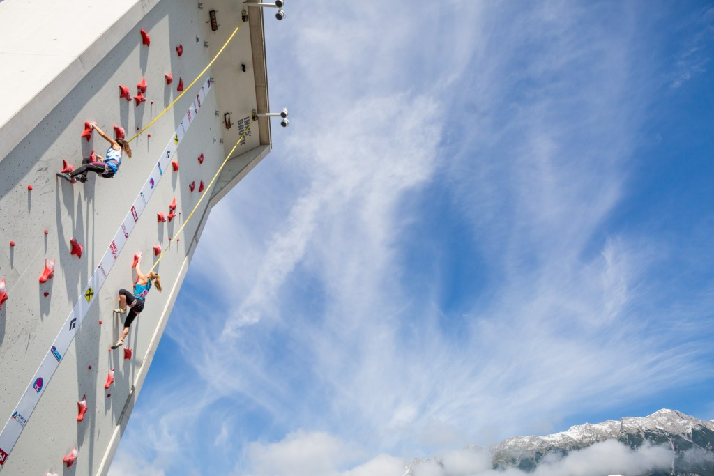 Outdoor Climbing Wall with 2 female climbers and sky
