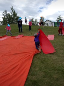 One of the children's favourite features was this tarp on a hill that could be used as a side. They experimented with different ways to slide down (solo, in pairs, on bums, knees, tummies and standing)