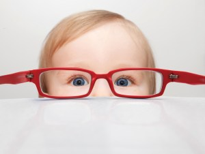 Toddler looking through glasses - treatment options for children