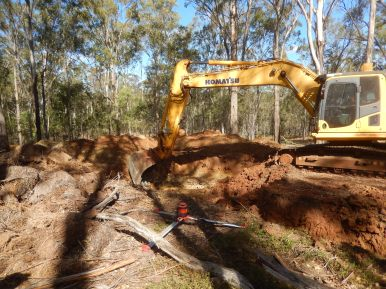 Excavator trench digging