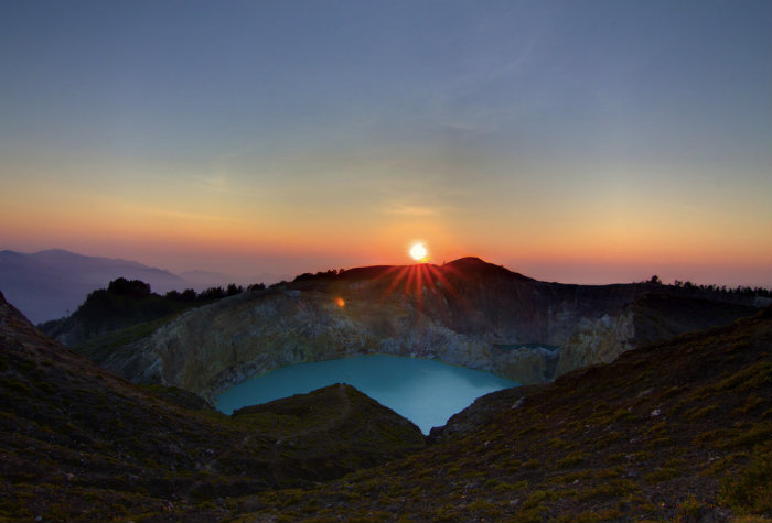 One of the three coloured lakes at Kelimutu as the sun rises.