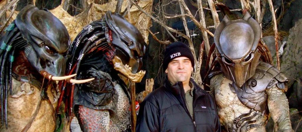 Director Nimród Antal poses with the 3 main Predator stars in costume on the set of Predators 2010.