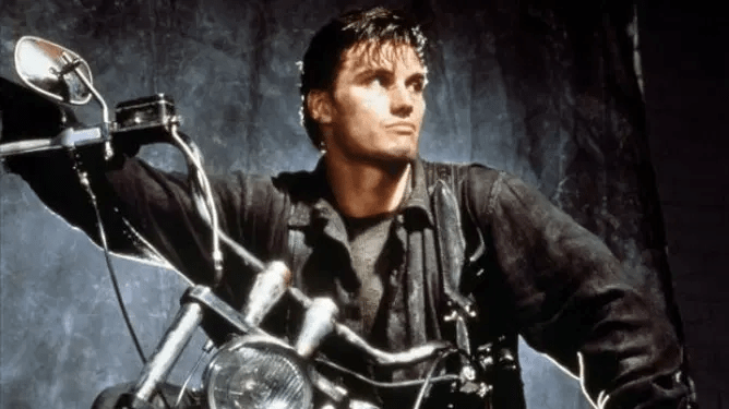 Dolph Lundgren on a black motorcycle as seen in the 1989 film adaptation of The Punisher.