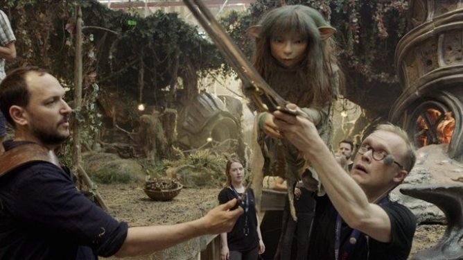 Director Louis Leterrier with a Gelfling puppeteer on the set of the The Dark Crystal: Age of Resistance.