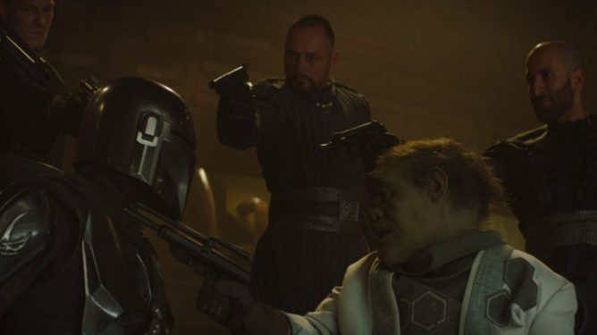 Pedro Pascal's titular character is faced at gun point in Chapter 9 of The Mandalorian.
