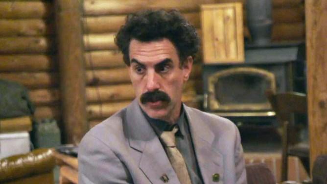 Borat sits in a cabin as seen in Borat 2