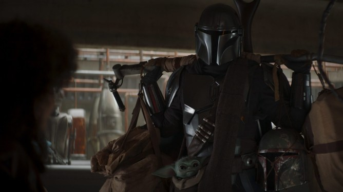 The Mandalorian carries his supplies and Baby Yoda inside a cantina as seen in Chapter 10.