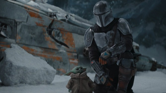 The Mandalorian and Baby Yoda get close to each other in front of a damaged ship in the snow as seen in Chapter 10.