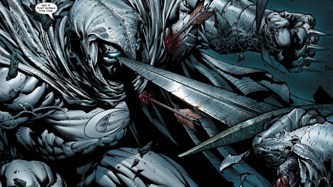 A bloodied Moon Knight faces an enemy putting a sword to his face as seen in Marvel Comics.