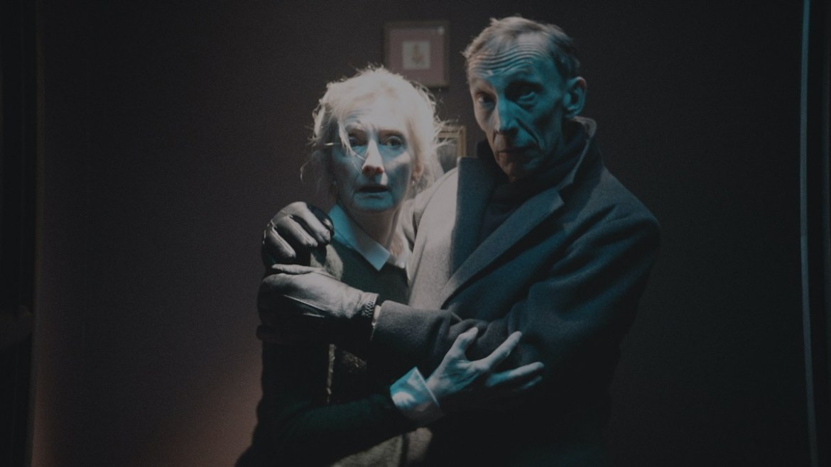 Sheila McCarthy and Julian Richings hold each other in fear and shock as seen in the Shudder exclusive Anything for Jackson.