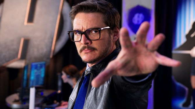 Pedro Pascal dramatically reaches for his swords as he prepares to suit up as seen in We Can Be Heroes directed by Robert Rodriguez.