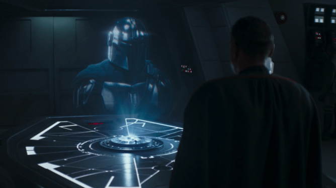Pedro Pascal's Mando gives Moff Gideon played by Giancarlo Esposito a message through hologram as seen in Chapter 15 of The Mandalorian.
