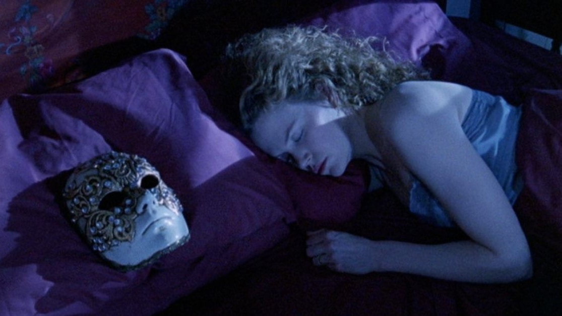 Nicole Kidman laying in bed as seen in Stanley Kubrick's Eyes Wide Shut coming to Hulu this December.