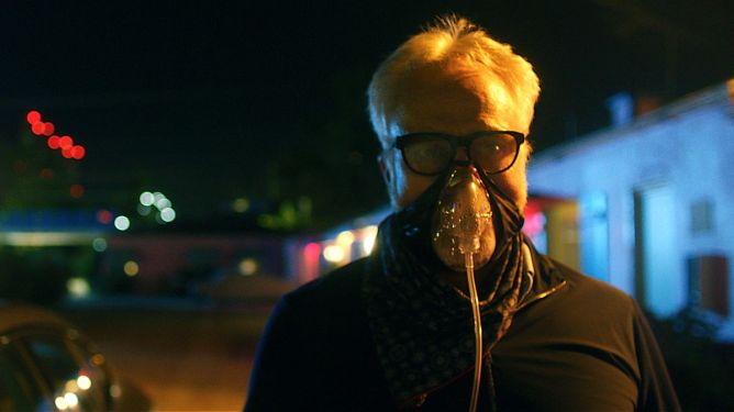 Bradley Whitford wearing a breathing mask to stay safe from the mutated COVID-19 plague as seen in Songbird.