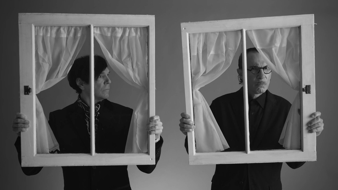 The Sparks Brothers holding fake windows to their faces as seen in Edgar Wright's documentary debut, an official 2021 Sundance selection.