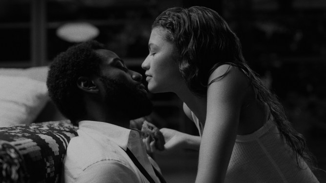 Zendaya and John David Washington share an intimate kiss as seen in the black-and-white film Malcolm & Marie.