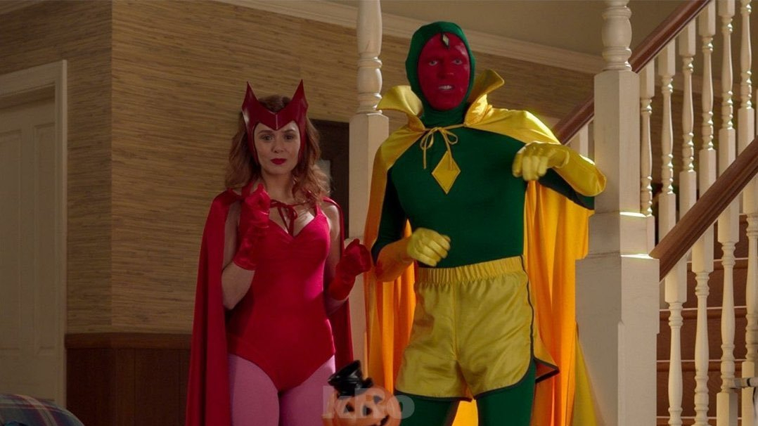 Wanda Maximoff and Vision wearing their classic comic inspired Halloween costumes as seen in Episode 6 of WandaVision.