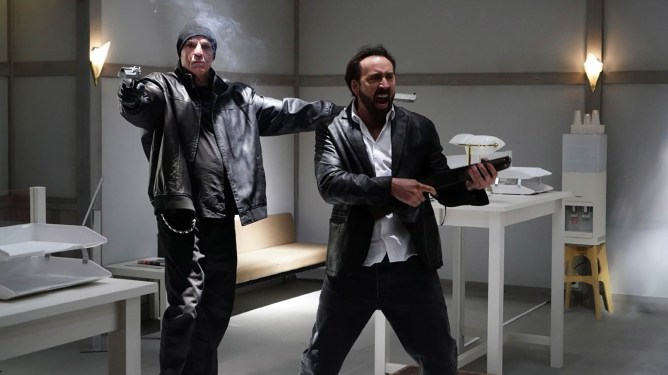 Nick Cassavetes and Nicolas Cage robbing a bank with force as seen in Prisoners of the Ghostland.