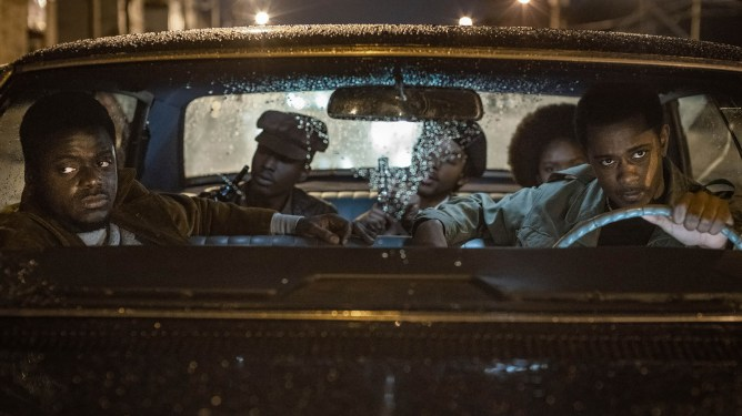 Daniel Kaluuya and Lakeith Stanfield riding in a car with other Black Panthers as seen in Judas and the Black Messiah.