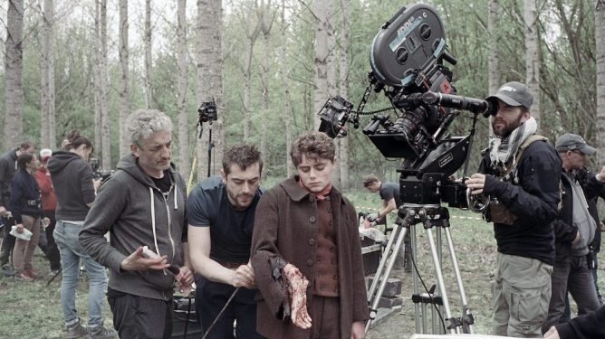 Sean Ellis using a camera to direct a scene with gore and practical effects on the set of Eight for Silver.