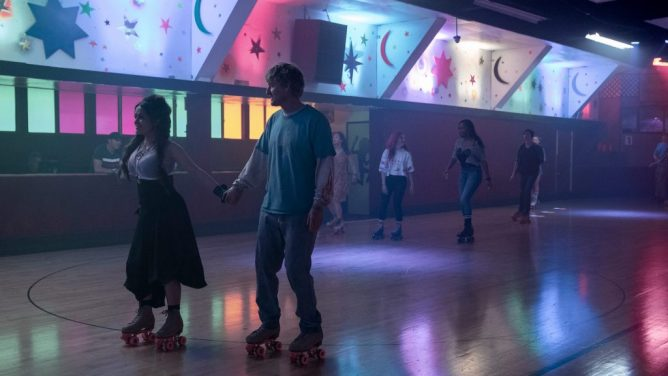 Owen Wilson and Salma Hayek skating in a colorful roller rink as seen in Bliss directed by Mike Cahill.