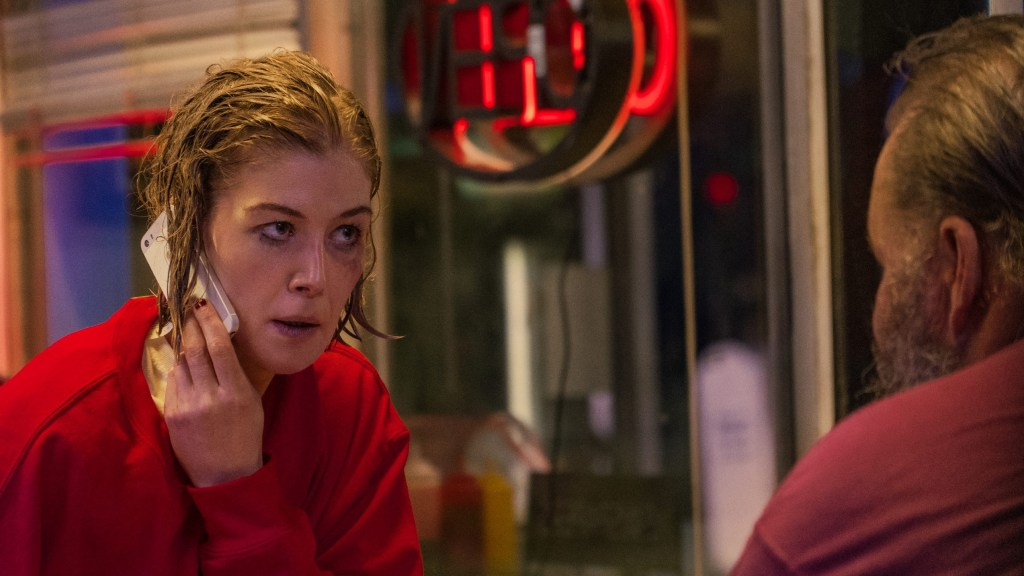 Rosamund Pike wearing red with messy makeup in distress as seen in the Netflix film I Care A Lot.