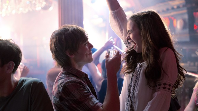 Lily Collins and Sam Claflin partying in 2014 romance drama Love, Rosie.