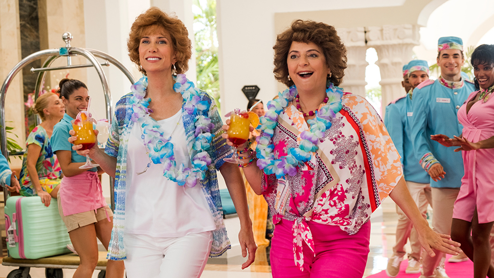 Kristen Wiig and Annie Mumolo walking into a vacation resort as seen in Barb and Star Go to Vista Del Mar.