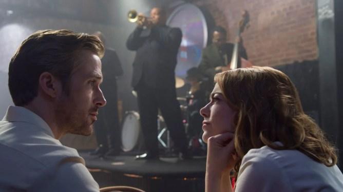 Emma Stone's Mia listening to Ryan Gosling as Seb in a jazz club in La La Land.