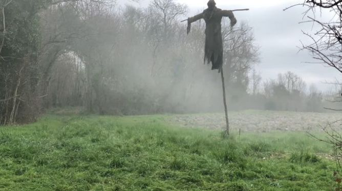 A horrifying scarecrow on a foggy field as seen in Eight for Silver directed by Sean Ellis.