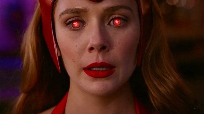 Elisabeth Olsen as Wanda Maximoff using her evil hex powers as seen in episode 6 of WandaVision.