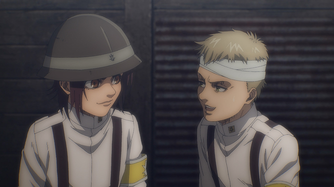 Gabi Braun, wearing a helmet and uniform, speaks to Falco Grice, who has bandages on his head, in Attack on Titan